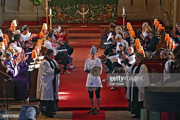 Race winner Lianne Fisher is presented with an award in St Peter and St Paul Church during a Shrovetide service after running a record time of 5502...