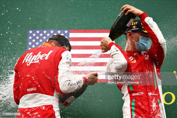 Race winner Logan Sargeant of United States and Prema Racing and second placed Frederik Vesti of Denmark and Prema Racing celebrate on the podium...