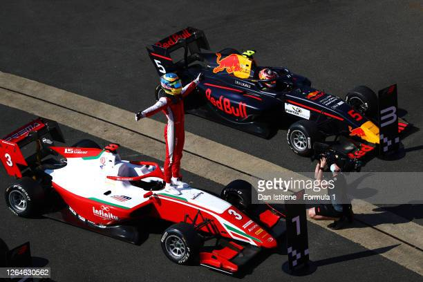 Race winner Logan Sargeant of United States and Prema Racing celebrates in parc ferme during race one of the Formula 3 Championship at Silverstone on...