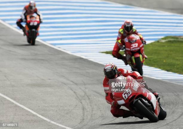 Race winner Loris Capirossi of Italy and Ducati leads Marco Melandri of Italy and Fortune Honda during the MotoGP of Spain at the Circuito de Jerez,...