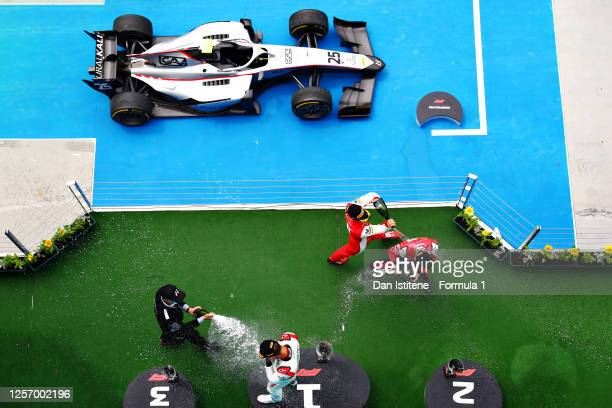 Race winner Luca Ghiotto of Italy and Hitech Grand Prix celebrates on the podium with second placed Callum Ilott of Great Britain and UNI-Virtuosi...