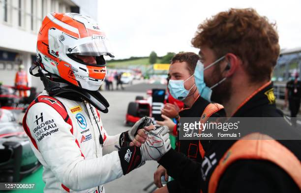Race winner Luca Ghiotto of Italy and Hitech Grand Prix celebrates with team mates in parc ferme during the sprint race of the Formula 2 Championship...