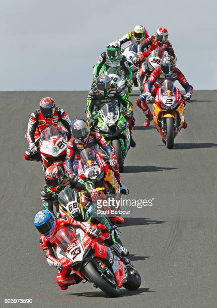 Race winner Marco Melandri of Italy and Arubait Racing Ducati leads riders over Lukey heights during race 2 in the FIM Superbike World Championship...