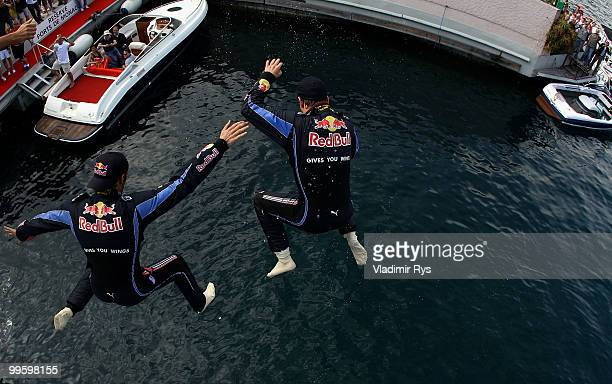Race winner Mark Webber of Australia and Red Bull Racing celebrates with second placed team mate Sebastian Vettel of Germany and Red Bull Racing by...