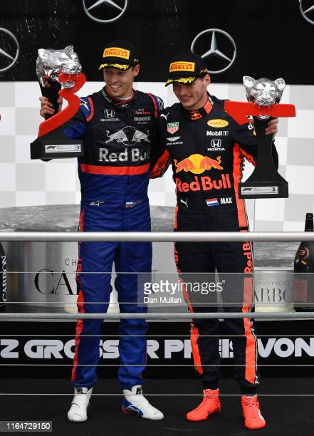 Race winner Max Verstappen of Netherlands and Red Bull Racing and third placed Daniil Kvyat of Russia and Scuderia Toro Rosso celebrate on the podium...