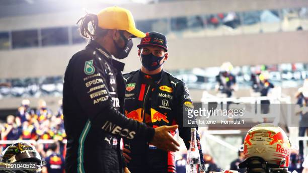 Race winner Max Verstappen of Netherlands and Red Bull Racing and third placed Lewis Hamilton of Great Britain and Mercedes GP talk in parc ferme...