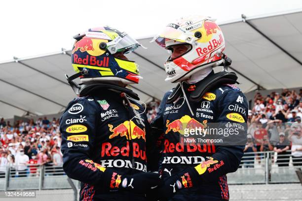 Race winner Max Verstappen of Netherlands and Red Bull Racing and third placed Sergio Perez of Mexico and Red Bull Racing celebrate in parc ferme...