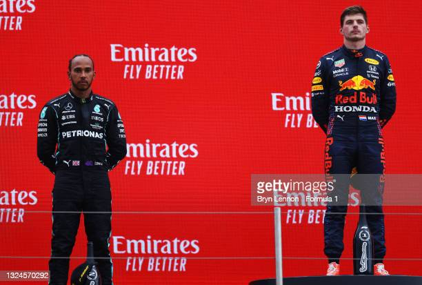 Race Winner, Max Verstappen of Netherlands and Red Bull Racing and Second placed Lewis Hamilton of Great Britain and Mercedes GP celebrates on the...