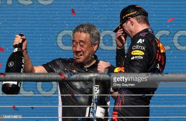 Race winner Max Verstappen of Netherlands and Red Bull Racing and Masashi Yamamoto of Honda celebrate on the podium during the F1 Grand Prix of USA...