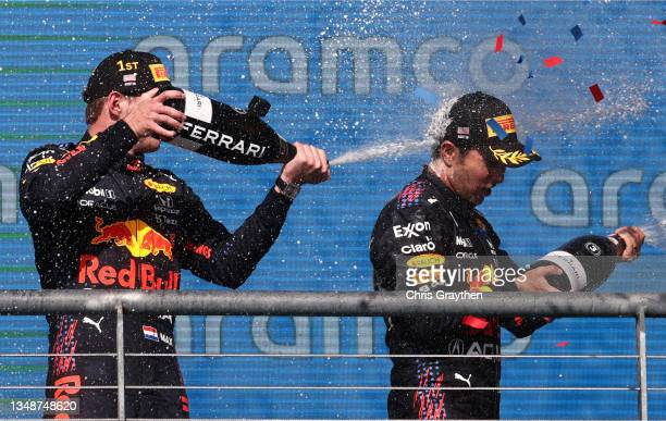 Race winner Max Verstappen of Netherlands and Red Bull Racing and third placed Sergio Perez of Mexico and Red Bull Racing celebrate on the podium...