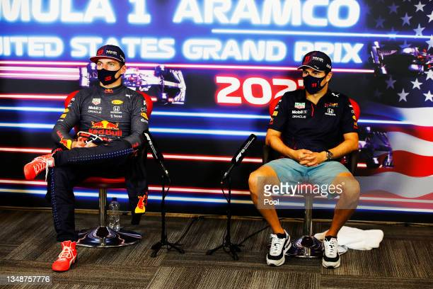 Race winner Max Verstappen of Netherlands and Red Bull Racing and third placed Sergio Perez of Mexico and Red Bull Racing talk in the press...
