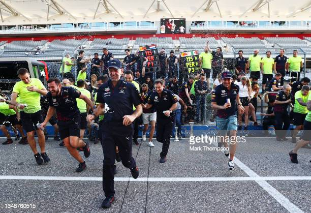 Race winner Max Verstappen of Netherlands and Red Bull Racing and third placed Sergio Perez of Mexico and Red Bull Racing celebrate with their team...