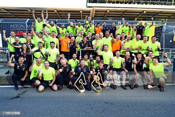 Race winner Max Verstappen of Netherlands and Red Bull Racing and the Red Bull Racing team celebrate after the F1 Grand Prix of Austria at Red Bull...