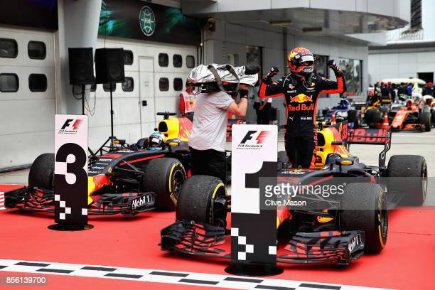 Race winner Max Verstappen of Netherlands and Red Bull Racing celebrates in parc ferme during the Malaysia Formula One Grand Prix at Sepang Circuit...