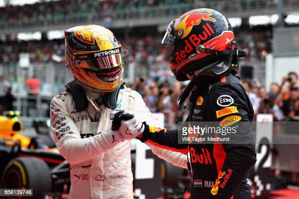 Race winner Max Verstappen of Netherlands and Red Bull Racing is congratulated by Lewis Hamilton of Great Britain and Mercedes GP in parc ferme...