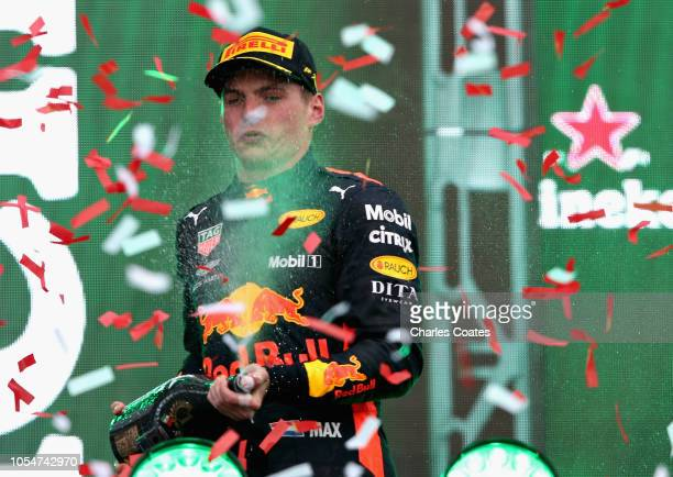 Race winner Max Verstappen of Netherlands and Red Bull Racing celebrates on the podium during the Formula One Grand Prix of Mexico at Autodromo...