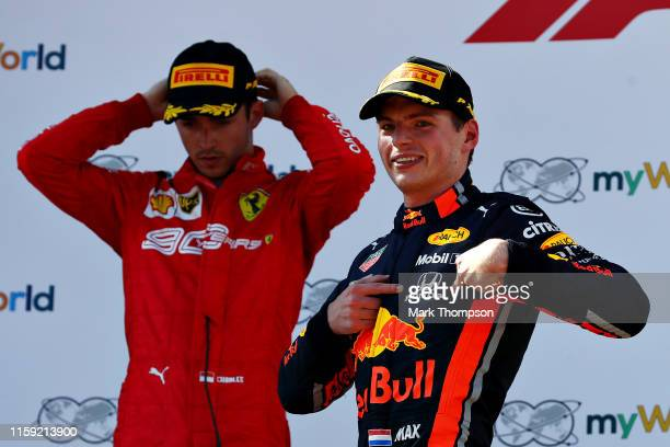 Race winner Max Verstappen of Netherlands and Red Bull Racing celebrates on the podium as second placed Charles Leclerc of Monaco and Ferrari looks...