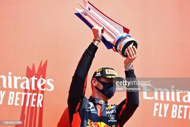 Race winner Max Verstappen of Netherlands and Red Bull Racing celebrates on the podium during the F1 70th Anniversary Grand Prix at Silverstone on...