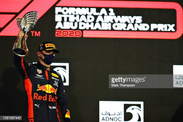 Race winner Max Verstappen of Netherlands and Red Bull Racing celebrates on the podium during the F1 Grand Prix of Abu Dhabi at Yas Marina Circuit on...