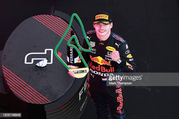 Race winner Max Verstappen of Netherlands and Red Bull Racing celebrates on the podium during the F1 Grand Prix of Styria at Red Bull Ring on June...