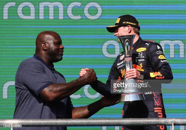 Race winner Max Verstappen of Netherlands and Red Bull Racing celebrates on the podium with NBA legend Shaquille O'Neal during the F1 Grand Prix of...