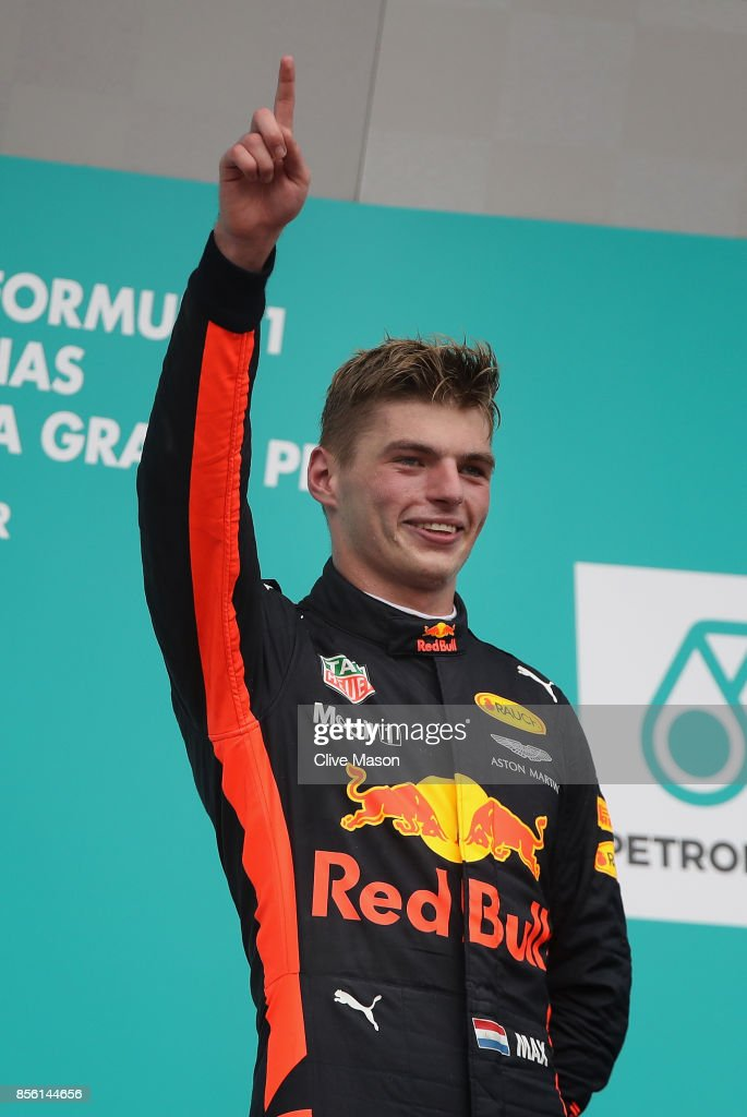 Race winner Max Verstappen of Netherlands and Red Bull Racing celebrates on the podium during the Malaysia Formula One Grand Prix at Sepang Circuit on October 1, 2017 in Kuala Lumpur, Malaysia.