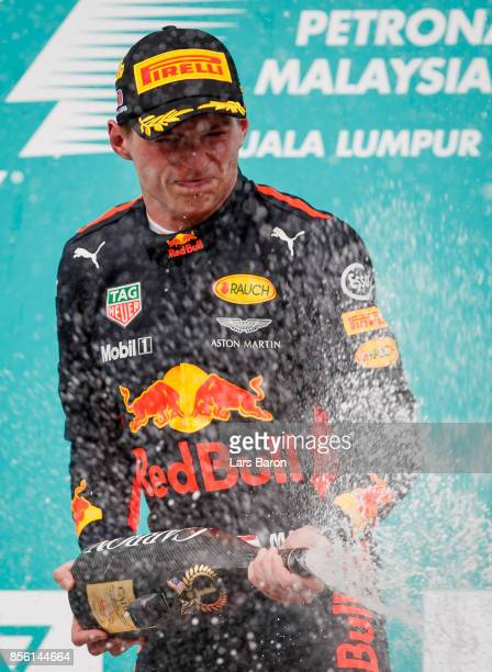 Race winner Max Verstappen of Netherlands and Red Bull Racing celebrates on the podium during the Malaysia Formula One Grand Prix at Sepang Circuit...