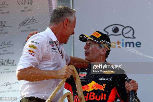 Race winner Max Verstappen of Netherlands and Red Bull Racing celebrates on the podium with Red Bull Racing Team Manager Jonathan Wheatley during the...