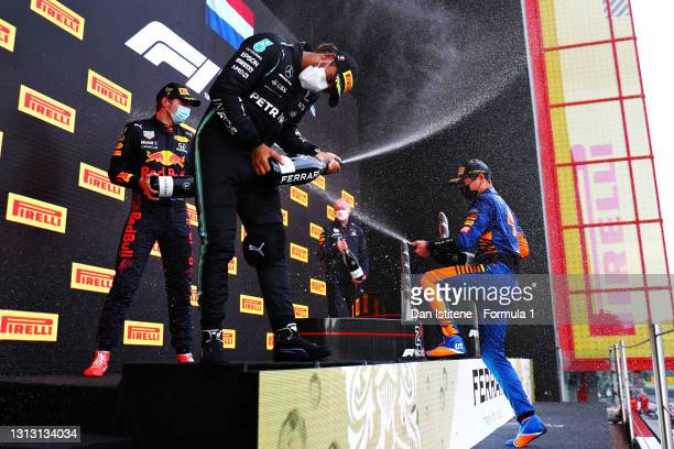 Race winner Max Verstappen of Netherlands and Red Bull Racing, second placed Lewis Hamilton of Great Britain and Mercedes GP and third placed Lando...