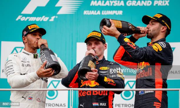 Race winner Max Verstappen of Netherlands and Red Bull Racing second place finisher Lewis Hamilton of Great Britain and Mercedes GP and third place...