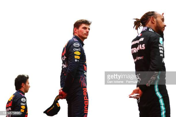 Race winner Max Verstappen of Netherlands and Red Bull Racing stands on the podium with third placed Sergio Perez of Mexico and Red Bull Racing and...