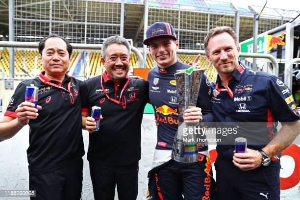 Race winner Max Verstappen of Netherlands and Red Bull Racing, Toyoharu Tanabe of Honda, Masashi Yamamoto of Honda and Red Bull Racing Team Principal...