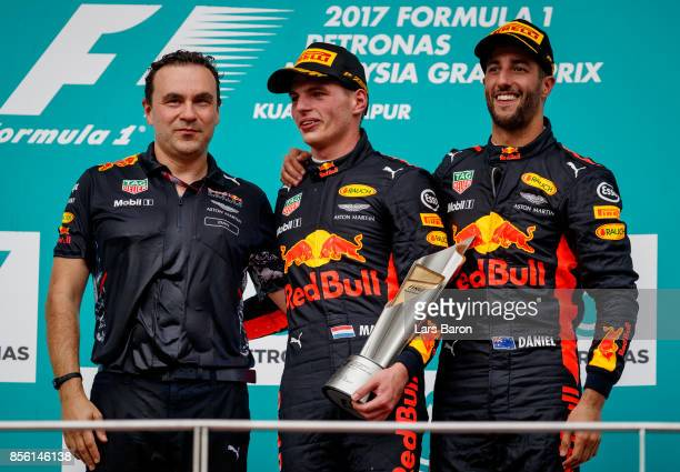 Race winner Max Verstappen of Netherlands and Red Bull Racing third place finisher Daniel Ricciardo of Australia and Red Bull Racing and Dan Fallows...