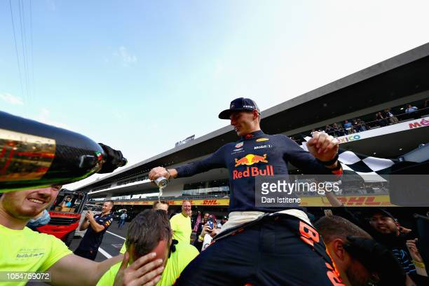 Race winner Max Verstappen of Netherlands and Red Bull Racing celebrates with his team after the Formula One Grand Prix of Mexico at Autodromo...