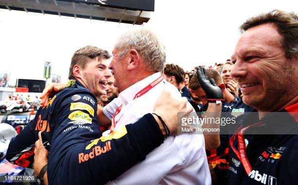 Race winner Max Verstappen of Netherlands and Red Bull Racing celebrates with Red Bull Racing Team Consultant Dr Helmut Marko in parc ferme during...