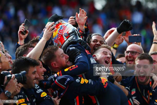 Race winner Max Verstappen of Netherlands and Red Bull Racing celebrates with the team in parc ferme during the F1 Grand Prix of Brazil at Autodromo...
