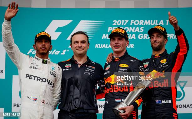 Race winner Max Verstappen of Netherlands and Red Bull Racing celebrates with second place finisher Lewis Hamilton of Great Britain and Mercedes GP...