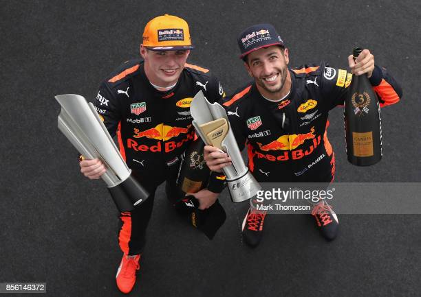 Race winner Max Verstappen of Netherlands and Red Bull Racing celebrates with third place finisher Daniel Ricciardo of Australia and Red Bull Racing...