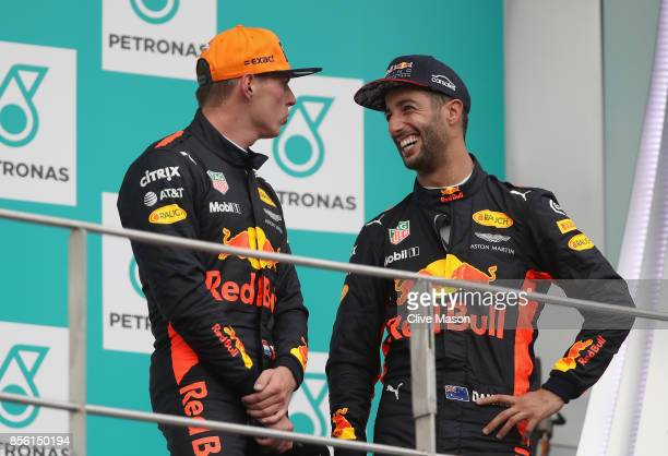 Race winner Max Verstappen of Netherlands and Red Bull Racing with third place finisher Daniel Ricciardo of Australia and Red Bull Racing on the...