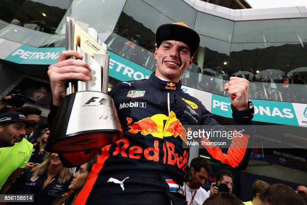 Race winner Max Verstappen of Netherlands and Red Bull Racing celebrates with his team during the Malaysia Formula One Grand Prix at Sepang Circuit...