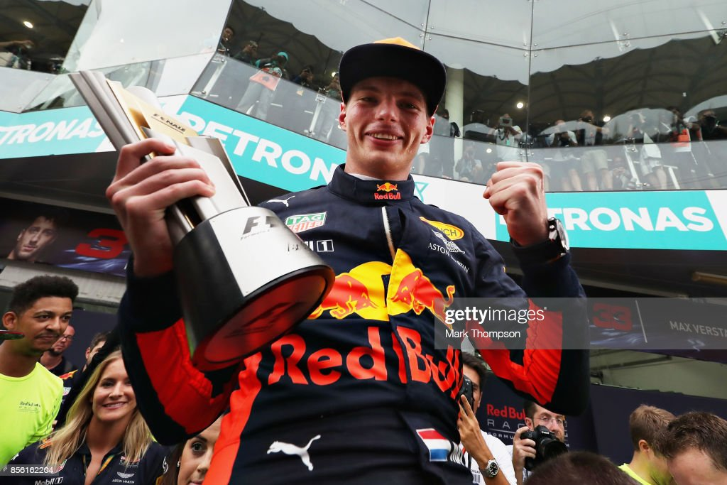 Race winner Max Verstappen of Netherlands and Red Bull Racing celebrates with his team during the Malaysia Formula One Grand Prix at Sepang Circuit on October 1, 2017 in Kuala Lumpur, Malaysia.