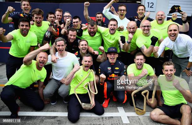 Race winner Max Verstappen of Netherlands and Red Bull Racing celebrates with his team after the Formula One Grand Prix of Austria at Red Bull Ring...