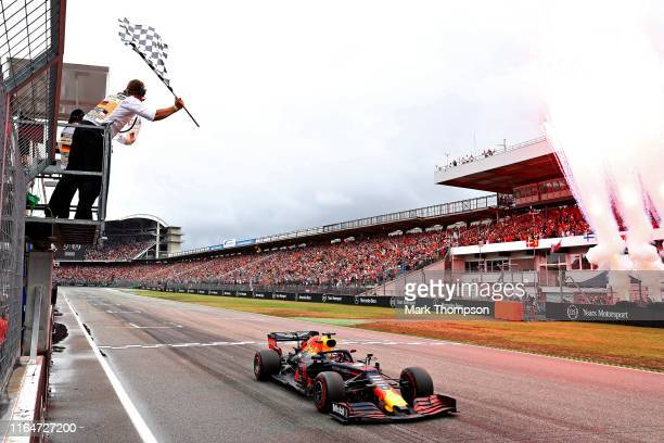 Race winner Max Verstappen of the Netherlands driving the Aston Martin Red Bull Racing RB15 takes the chequered flag and the win during the F1 Grand...