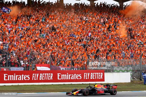 Race winner Max Verstappen of the Netherlands driving the Aston Martin Red Bull Racing RB15 celebrates with his fans during the F1 Grand Prix of...