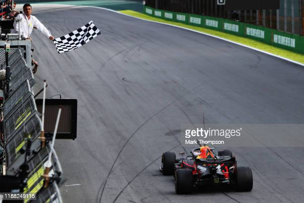Race winner Max Verstappen of the Netherlands driving the Aston Martin Red Bull Racing RB15 takes the chequered flag during the F1 Grand Prix of...