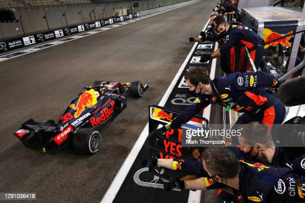 Race winner Max Verstappen of the Netherlands driving the Aston Martin Red Bull Racing RB16 passes his team celebrating on the pitwall during the F1...