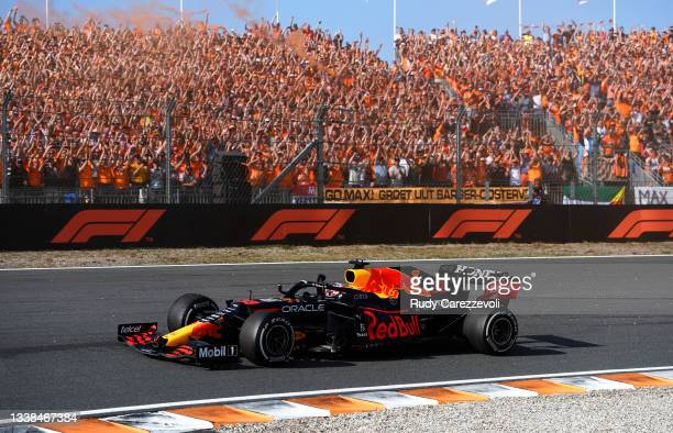 Race winner Max Verstappen of the Netherlands driving the Red Bull Racing RB16B Honda celebrates on his slowing down lap during the F1 Grand Prix of...