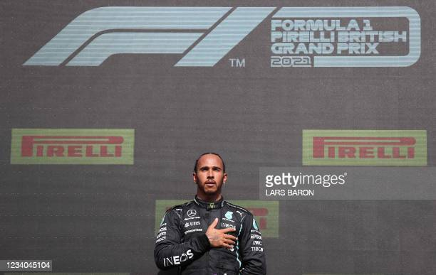 Race winner Mercedes' British driver Lewis Hamilton on the podium after the Formula One British Grand Prix motor race at Silverstone motor racing...