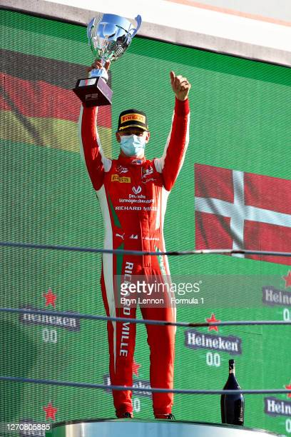 Race winner Mick Schumacher of Germany and Prema Racing celebrates on the podium during the feature race for the Formula 2 Championship at Autodromo...