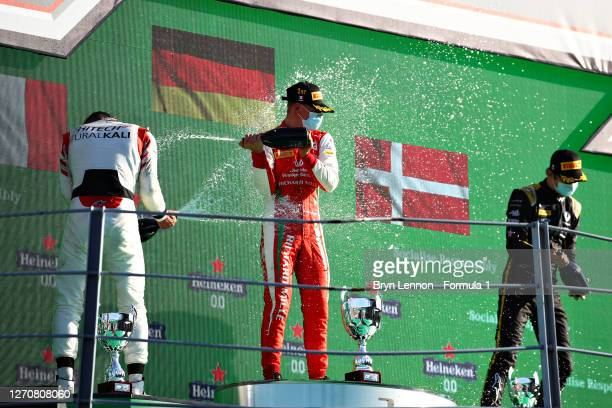 Race winner Mick Schumacher of Germany and Prema Racing, second placed Luca Ghiotto of Italy and Hitech Grand Prix and third placed Christian...
